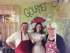 Troy Memis, owner of Holy Tomato Too with Anna Baldwin and manager Maryalice Isabella